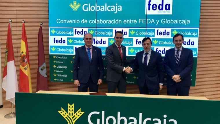 Pedro Palacios y Artemio Pérez renuevan el convenio financiero entre Globalcaja y FEDA